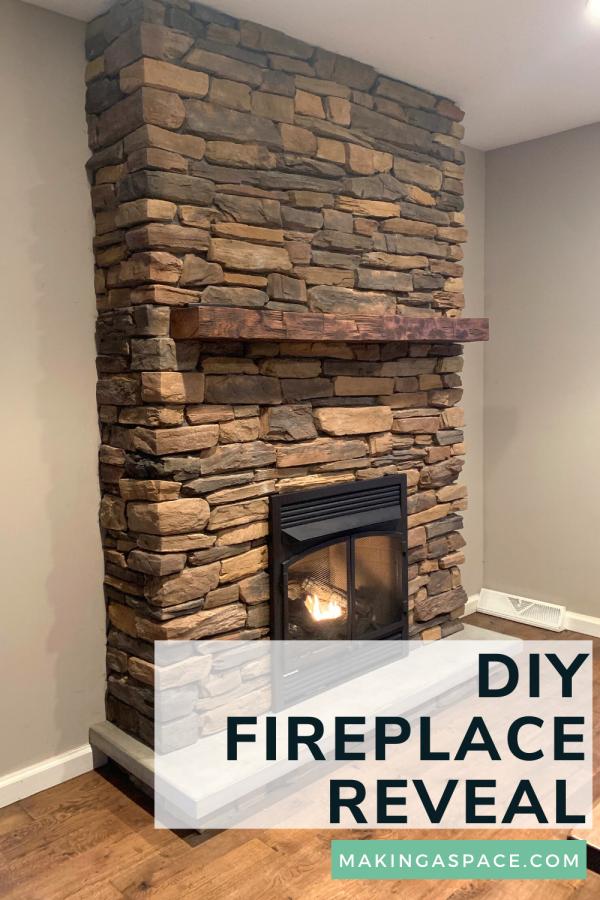stone fireplace with barnwood mantle